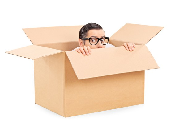 Man hiding in box